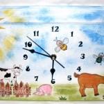 hodiny doplněny o 2D výřezy kravička, prasátko
